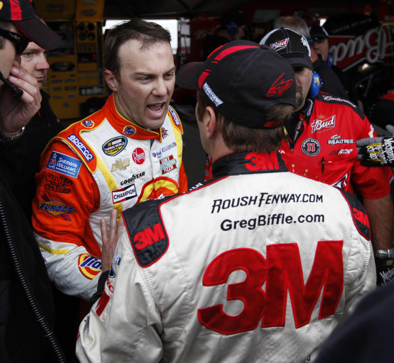 Drivers Kevin Harvick, left, and Greg Biffle, discuss an on track incident in the garage after practice for Sunday's NASCAR Sprint Cup auto race at the Martinsville Speedway in Martinsville, Va.,, Saturday, Oct. 29, 2011.   (AP Photo/Steve Helber)