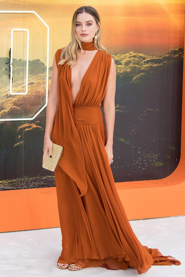 """<p>Who: Margot Robbie</p><p>When: July 30, 2019 </p><p>Wearing: Oscar de la Renta</p><p>Why: Margot Robbie has been making a style killing during her press tour of <em><em>Once Upon a Time... in Hollywood</em>, </em>and the premiere in London, England is no different. <a href=""""https://www.elle.com/fashion/celebrity-style/g28380118/best-dressed-july-2019/?slide=3"""" target=""""_blank"""">Once again she references the '70s</a> with this beautifully draped look. <em></em></p>"""