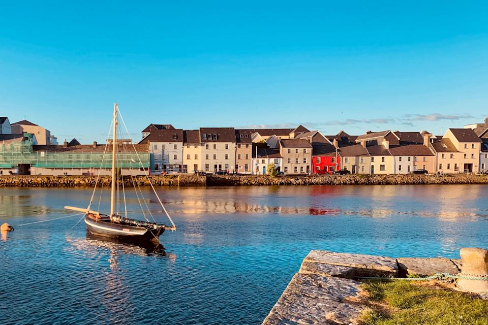 """Galway is in a prime location on <a href=""""https://www.cntraveler.com/galleries/2016-03-15/the-most-beautiful-places-in-ireland?mbid=synd_yahoo_rss"""" rel=""""nofollow noopener"""" target=""""_blank"""" data-ylk=""""slk:Ireland"""" class=""""link rapid-noclick-resp"""">Ireland</a>'s west coast, close to the <a href=""""https://www.cntraveler.com/gallery/exploring-irelands-beautiful-islands?mbid=synd_yahoo_rss"""" rel=""""nofollow noopener"""" target=""""_blank"""" data-ylk=""""slk:Aran Islands"""" class=""""link rapid-noclick-resp"""">Aran Islands</a> and <a href=""""https://www.cntraveler.com/gallery/western-ireland-a-closer-look-at-the-countrys-remote-rugged-coast?mbid=synd_yahoo_rss"""" rel=""""nofollow noopener"""" target=""""_blank"""" data-ylk=""""slk:Connemara region"""" class=""""link rapid-noclick-resp"""">Connemara region</a>. But the <a href=""""https://www.cntraveler.com/galleries/2016-03-15/the-most-beautiful-places-in-ireland?mbid=synd_yahoo_rss"""" rel=""""nofollow noopener"""" target=""""_blank"""" data-ylk=""""slk:town itself is so charming"""" class=""""link rapid-noclick-resp"""">town itself is so charming</a>, you might find yourself sticking close to the cobblestoned streets and ancient architecture for at least a day or two. Readers were particularly struck by the locals, who will instantly make you feel welcomed. During the day, make time to snap some photos of the Spanish Arch and the Claddagh; nights are reserved for sipping brews with the friendly crowds."""