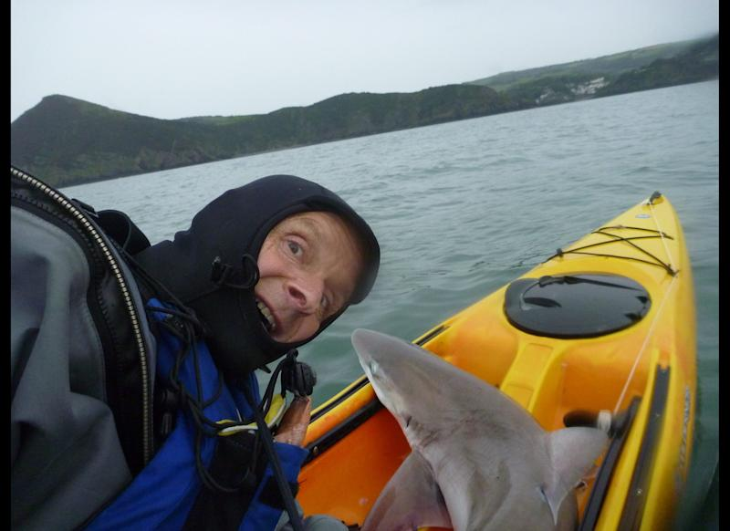 This is the jaw-dropping moment a canoeist landed a 6-foot shark after it dragged him through the water for 10 minutes. Brave Rupert Kirkwood, 51, had paddled a mile off the United Kingdom's Devon coast when he suddenly felt a snag on his line. The 70-pound beast nearly pulled him overboard, before pulling his 16-foot canoe through the water as he desperately clung on. After 10 minutes of wrestling with the beast, he eventually hauled the massive fish on board.