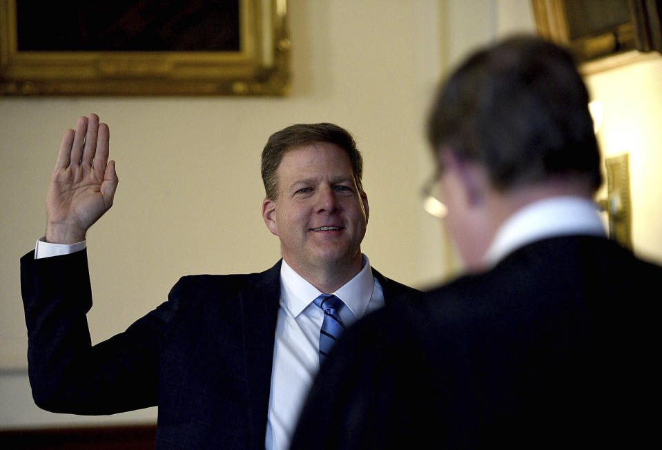 FILE - In this Thursday, Jan. 7, 2021 file photo, Gov. Chris Sununu is sworn in for his third term by Associate Justice Gary Hicks during his inauguration ceremony in the Executive Council Chamber at the State House in Concord, N.H. A measure that recently passed New Hampshire's Republican-led House would prohibit governors from indefinitely renewing emergency declarations, as Sununu has done every 21 days for the past year. It would halt emergency orders after 30 days unless renewed by lawmakers. (David Lane/The Union Leader via AP, Pool)