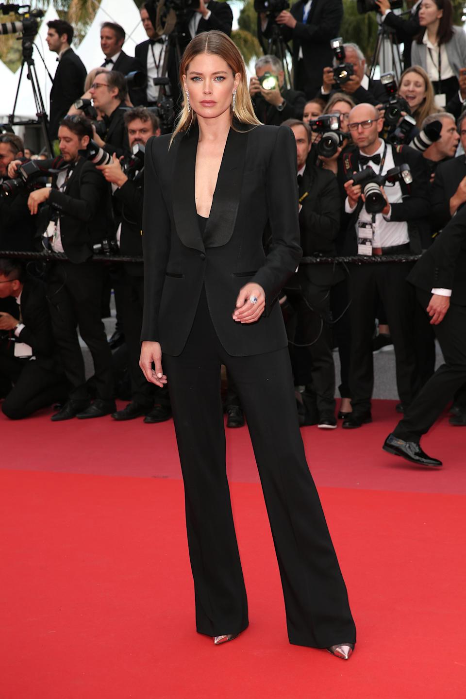 <p>Doutzen Kroes made a nice change from dresses at Cannes by opting for a strong-shouldered Tom Fordsuit.<br> [Photo: Getty] </p>