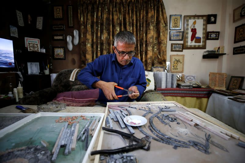 FILE PHOTO: Sales drop for Palestinian couple making mosaic artworks amid pandemic