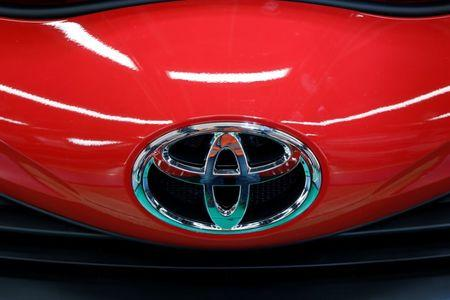 The Toyota Motor Corp. company logo is pictured on the production line of the Yaris at the company's plant in Onnaing, near Valenciennes