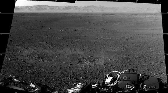 """These are the first two full-resolution images of the Martian surface from the Navigation cameras on NASA's Curiosity rover, which are located on the rover's """"head"""" or mast. The rim of Gale Crater can be seen in the distance beyond the pebbly g"""
