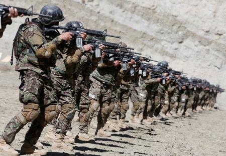 New recruits to the Afghan army Special Forces take part in a military exercise in Rishkhur district outside Kabul