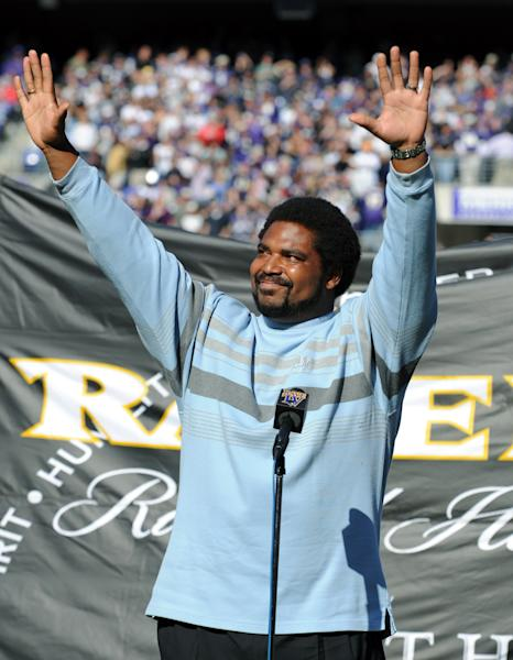 FILE - In this Oct. 26, 2008 file photo, former Baltimore Ravens player Jonathan Ogden waves to the crowd at halftime of the Ravens game against the Oakland Raiders in Baltimore. Ogden will be inducted into the Pro Football Hall of Fame on Saturday, Aug. 3, 2012 in Canton, Ohio. (AP Photo/Gail Burton, File)