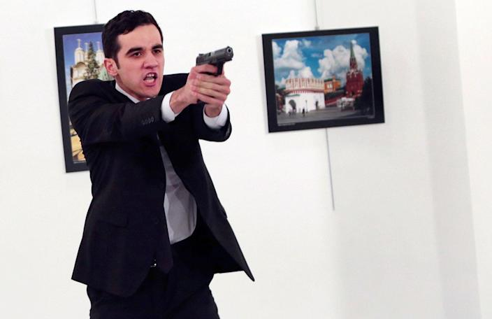 "<p>DEC. 19, 2016 — A man identified as Mevlut Mert Altintas holds up a gun after shooting Andrei Karlov, the Russian Ambassador to Turkey, at a photo gallery in Ankara, Turkey, Shouting ""Don't forget Aleppo! Don't forget Syria!"" Altintas fatally shot Karlov in front of stunned onlookers at a photo exhibit. Police killed the assailant after a shootout. (AP Photo/Burhan Ozbilici) </p>"