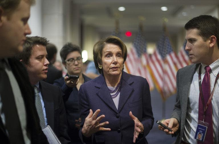 House Minority Leader Nancy Pelosi (C), D-CA, talks with reporters on Capitol Hill in Washington, December 5, 2013