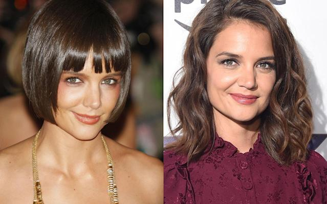 <p>Katie Holmes previously showed off an edgy cropped haircut and smoky eye makeup, but her side-parted lob-length waves and subtle makeup give her a fresh and youthful look. (Photo: Getty Images) </p>