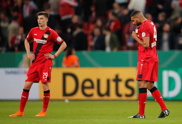 Soccer Football - DFB Cup - Bayer Leverkusen vs Bayern Munich - BayArena, Leverkusen, Germany - April 17, 2018 Bayer Leverkusen's Kai Havertz and Jonathan Tah look dejected after the match REUTERS/Wolfgang Rattay DFB RULES PROHIBIT USE IN MMS SERVICES VIA HANDHELD DEVICES UNTIL TWO HOURS AFTER A MATCH AND ANY USAGE ON INTERNET OR ONLINE MEDIA SIMULATING VIDEO FOOTAGE DURING THE MATCH.