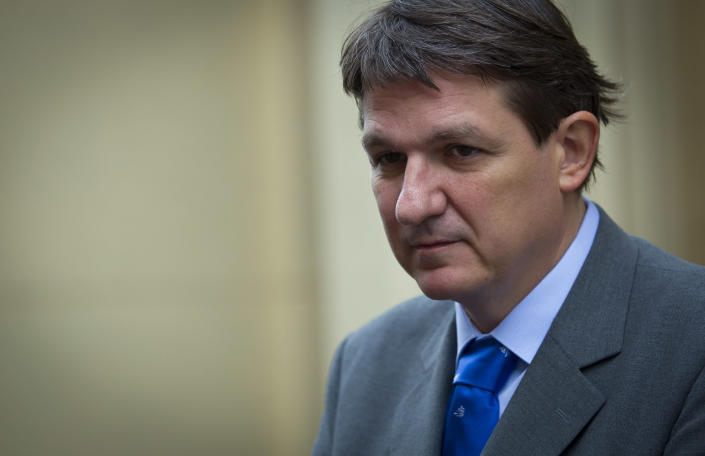 Slovenia's Finance Minister Janez Sustersic talks during an interview with the Associated Press in Ljubljana, Slovenia, Wednesday, Sept. 26, 2012. Sustersic said his country will try to avoid seeking EU financial assistance by adopting reforms of the pension and labor laws in the country's bitterly divided parliament where Jansa's center-right ruling coalition is odds with opposition on how to tackle the crisis. (AP Photo/Darko Bandic)