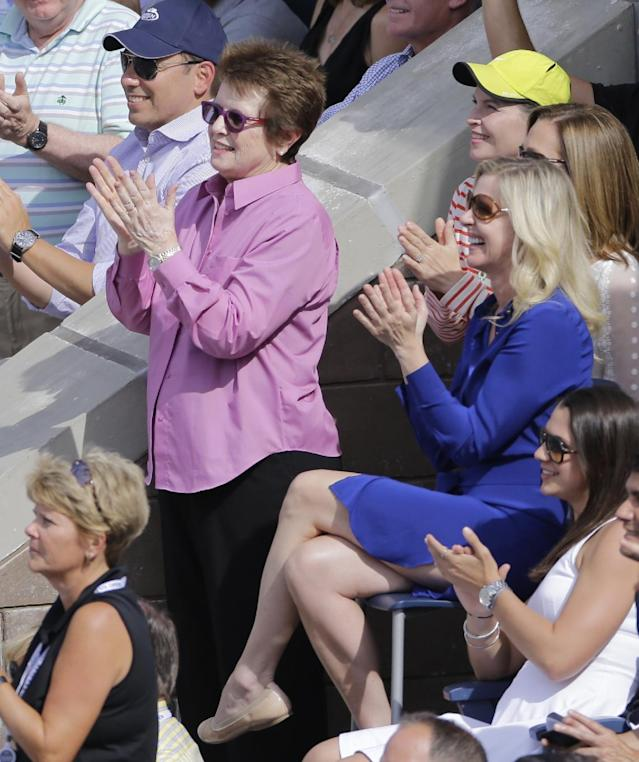 Billie Jean King, left, applauds during the semifinals of the 2013 U.S. Open tennis tournament, Saturday, Sept. 7, 2013, in New York. (AP Photo/Mike Groll)