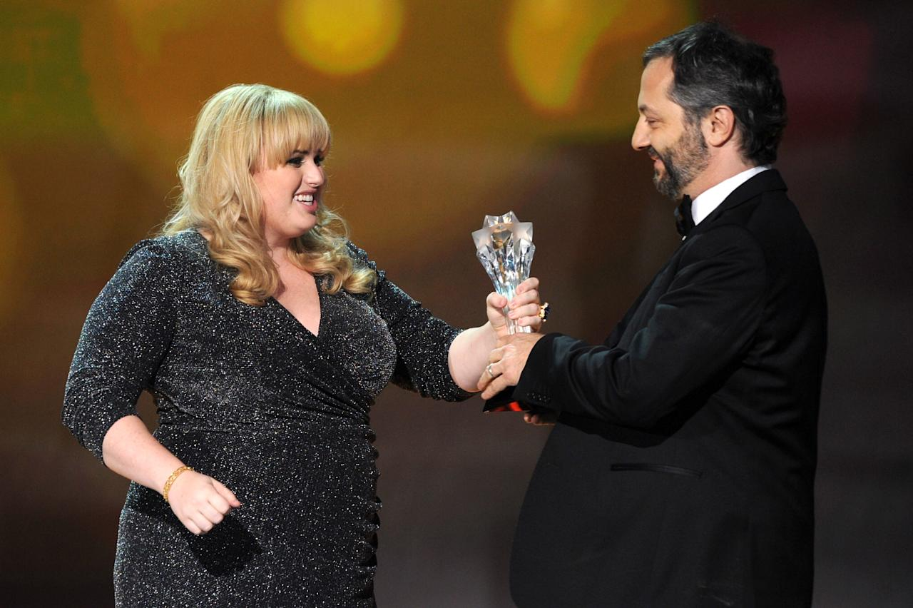 SANTA MONICA, CA - JANUARY 10:  Actress Rebel Wilson (L) presents Director Judd apatow the Critics Choice Louis the XIII Genius Award onstage at the 18th Annual Critics' Choice Movie Awards held at Barker Hangar on January 10, 2013 in Santa Monica, California.  (Photo by Kevin Winter/Getty Images)