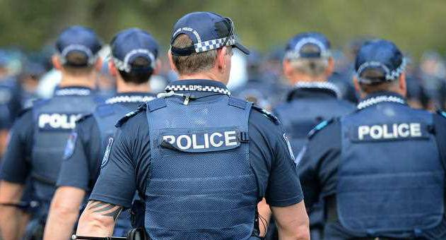 Queensland Police officers are pictured.