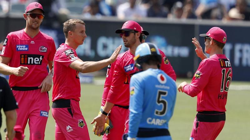 Tom Curran took 4-22 as the Sydney Sixers dismissed the Strikers for 135 at the Adelaide Oval