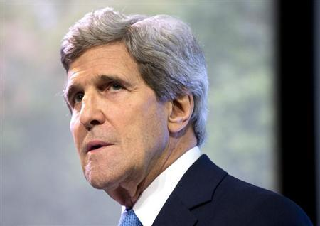 U.S. Secretary of State John Kerry pauses as he delivers a speech on climate change in Jakarta