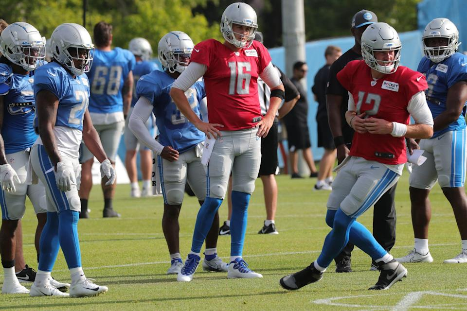 Detroit Lions quarterbacks Jared Goff and Tim Boyle go through drills during training camp Tuesday, August 3, 2021.