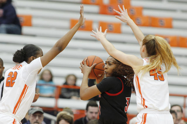 Louisville's Bionca Dunham, center, tries the pass the ball while guarded by Syracuse's Amaya Finklea-Guity, left, and Digna Strautmane. (AP Photo/Nick Lisi)