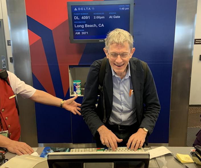 Helping hand: Simon Calder auditions ineffectively as a member of Delta ground staff: Douglas Bolton