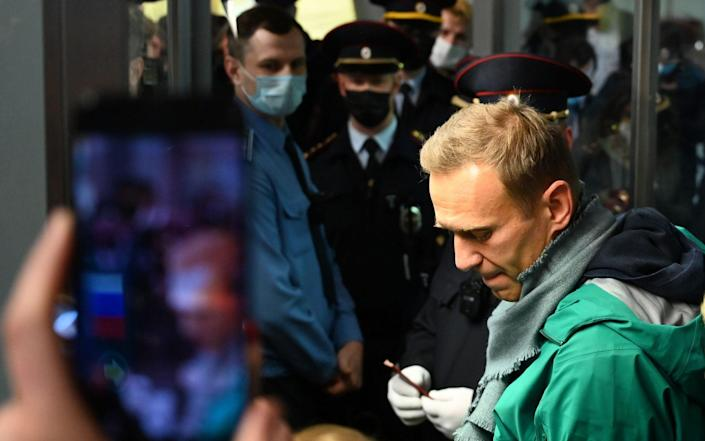 Alexei Navalny was detained at passport control at Moscow's Sheremetyevo airport on Sunday evening - Kirill Kudryavtsev/AFP
