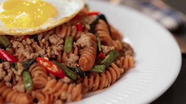 Thai Basil Pork with Red Lentil Fusilli and sunny side up