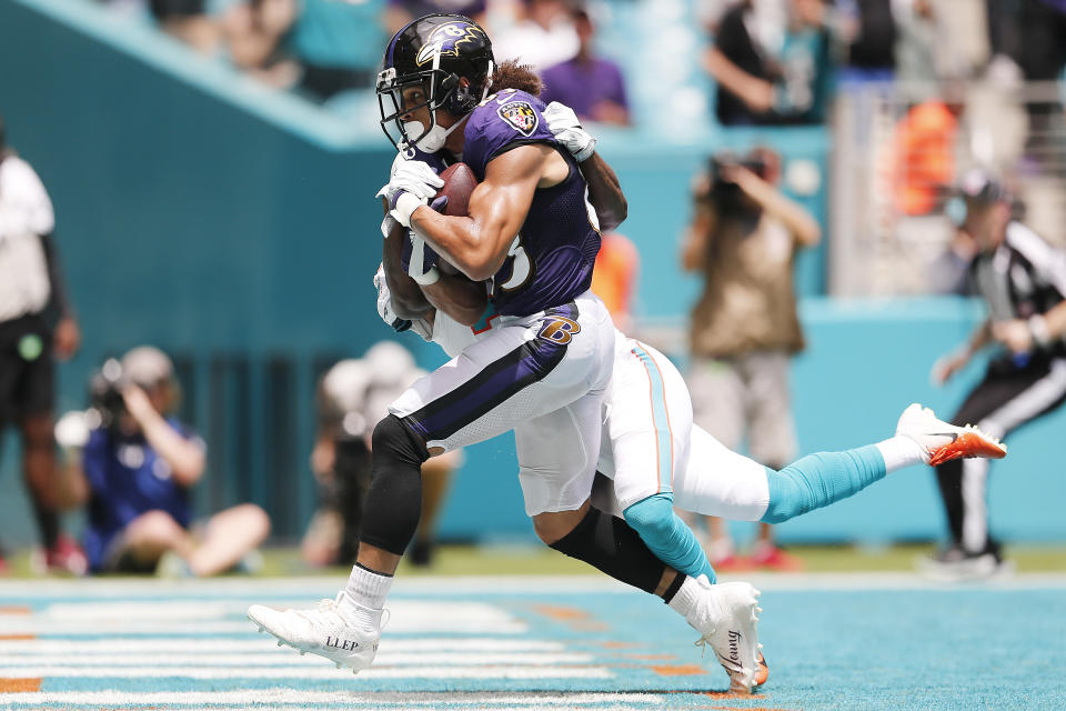 Willie Snead #83 of the Baltimore Ravens makes a catch for a touchdown against Jomal Wiltz #33 of the Miami Dolphins during the second quarter at Hard Rock Stadium on September 08, 2019 in Miami, Florida. (Photo by Michael Reaves/Getty Images)