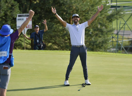 Erik van Rooyen of South Africa celebrates after winning the PGA European Tour golf tournament Scandinavian Invitation at Hills Golf & Sports Club in Molndal, Sweden, Sunday Aug. 25, 2019. (Anders Wiklund/TT via AP)