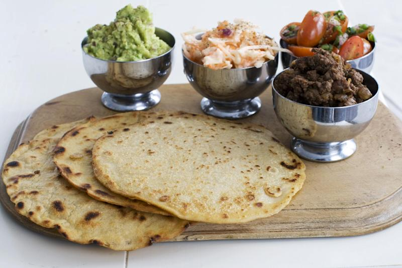 In this image taken on March 4, 2013, tortillas with tomato-mint salsa and guacamole are shown in Concord, N.H. (AP Photo/Matthew Mead)