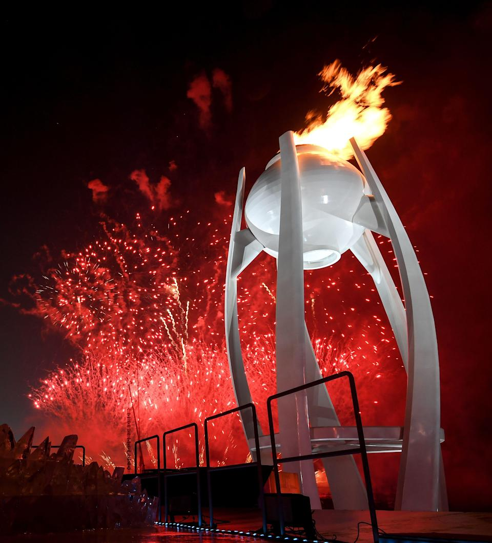 <p>Fireworks erupt as the cauldron is lit with the Olympic flame during the opening ceremony of the Pyeongchang 2018 Winter Olympic Games at the Pyeongchang Stadium on February 9, 2018. / AFP PHOTO / POOL / FRANCK FIFE </p>