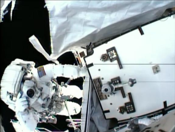 NASA astronaut Tom Marshburn snaps a photo of crewmate Chris Cassidy during a May 11, 2013 spacewalk in this view from Cassidy's helmet camera. The spacewalkers replaced an ammonia pump box while seeking a coolant leak outside the International