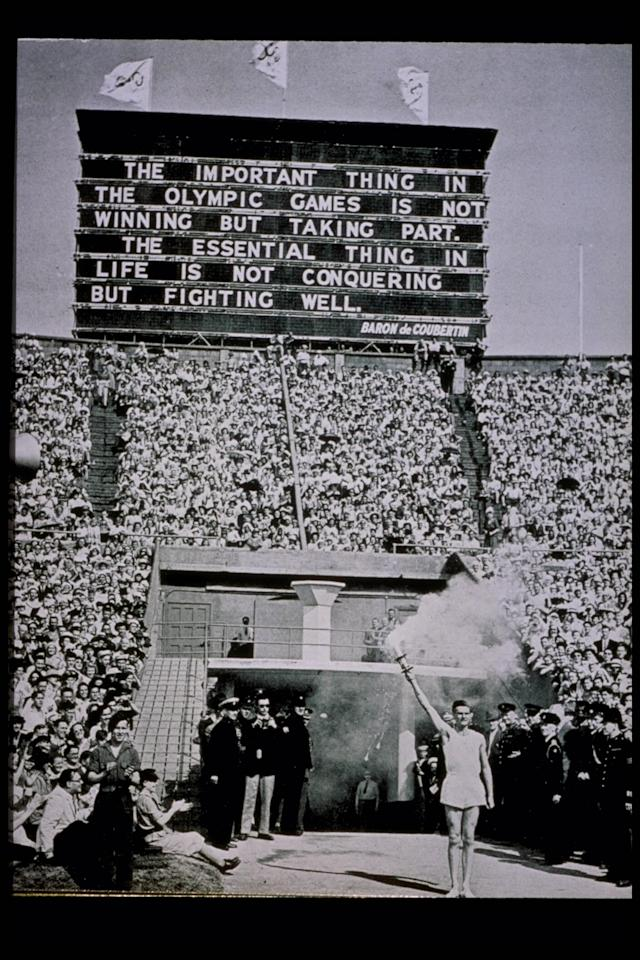 Jul 1948: The Olympic Torch is presented at the 1948 Summer Olympic Games at Wembley Stadium in London, England. Mandatory Credit: Allsport/Allsport