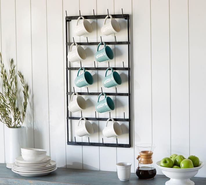"<h3><a href=""https://www.potterybarn.com/products/vintage-blacksmith-wall-mug-rack/"" rel=""nofollow noopener"" target=""_blank"" data-ylk=""slk:Pottery Barn Vintage Blacksmith Metal Wall Mug Rack"" class=""link rapid-noclick-resp"">Pottery Barn Vintage Blacksmith Metal Wall Mug Rack</a></h3> <br>If you <em>are</em> allowed to make holes in your wall (aka you own your place or your landlord is a legend), then wall-mounting storage is the best way to free up space on your counters and in your cupboards or drawers. This hanging rack is perfect for the kitchen and has enough different elements to make sure all those mugs and more find a new (secure) home.<br><br><br><br><br><strong>Pottery Barn</strong> Vintage Blacksmith Metal Wall Mug Rack, $, available at <a href=""https://go.skimresources.com/?id=30283X879131&url=https%3A%2F%2Fwww.potterybarn.com%2Fproducts%2Fvintage-blacksmith-wall-mug-rack%2F"" rel=""nofollow noopener"" target=""_blank"" data-ylk=""slk:Pottery Barn"" class=""link rapid-noclick-resp"">Pottery Barn</a><br><br><br><br>"