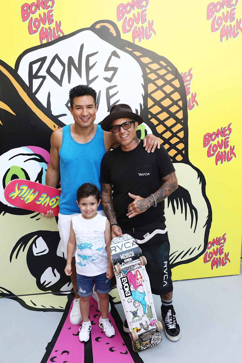 Mario Lopez and son, Nico, pose with Christian Hosoi, right, of the Bones Love Milk Skate Team, at an event hosted by the California Milk Processor Board dedicated to celebrating skate and California street culture while showcasing the real benefits of milk as nature's energy drink, Wednesday, July 24, 2019, in Huntington Beach, Calif. (Photo by Matt Sayles/Invision for CMPB/AP Images)