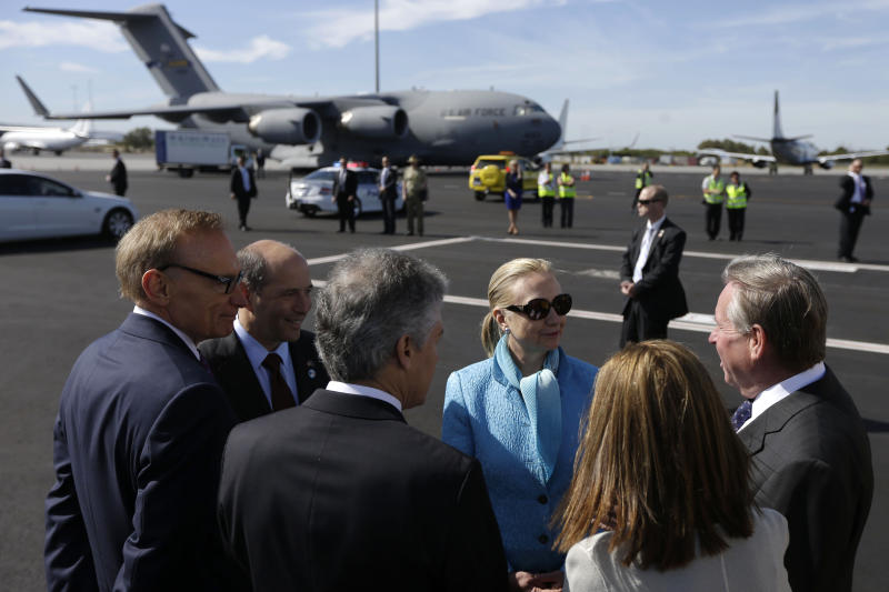 U.S. Secretary of State Hillary Rodham Clinton, center, meets with from left Australian Foreign Minister Bob Carr, U.S. Ambassador to Australia Jeffrey Bleich, Australian Defense Minister Stephen Smith, Lyn Barnett, and her husband Western Australia Premier Colin Barnett, upon her arrival at Perth International Airport, Tuesday, Nov. 13, 2012, in Perth, Australia. (AP Photo/Matt Rourke, Pool)