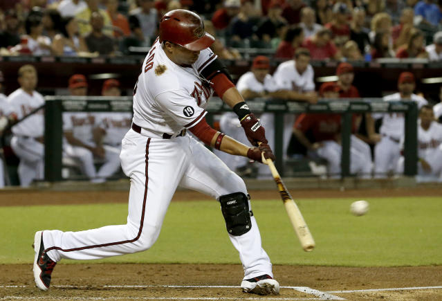 Arizona Diamondbacks' Martin Prado connects for an RBI-singe against the San Diego Padres in the first inning of a baseball game on Friday, July 26, 2013, in Phoenix. (AP Photo/Ross D. Franklin)