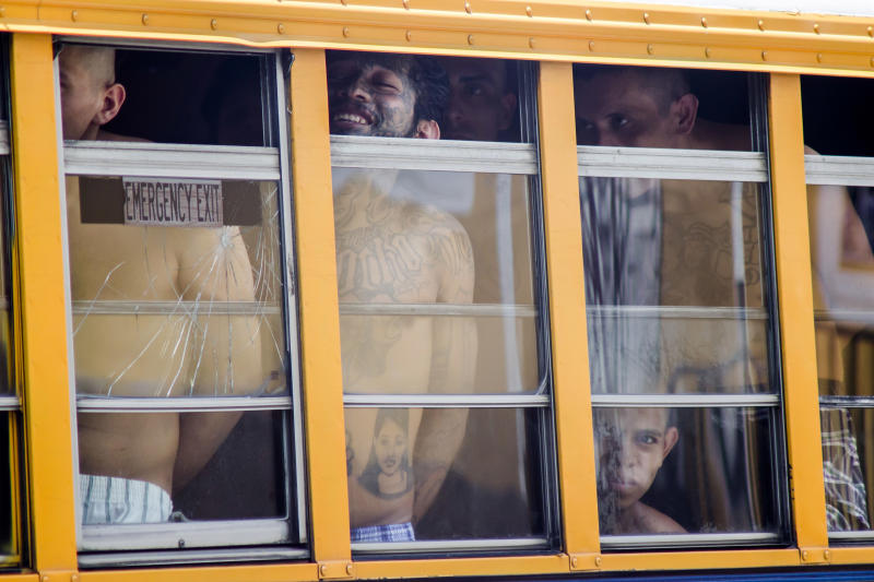 FILE - In this June 16, 2016 file photo, inmates ride in a bus out of the Cojutepeque prison in El Salvador. El Salvador had a homicide rate of 50.3 per 100,000 people in 2018. President Donald Trump said that he is cutting off nearly $500 million in aid to Honduras, Guatemala and El Salvador help reduce immigration. The aid is meant to promote democracy-building, good governance, trade, agriculture, education, health and public safety and law enforcement. Experts say all of those areas play a direct role in whether people feel they can survive in their home country.(AP Photo/Salvador Melendez, File)
