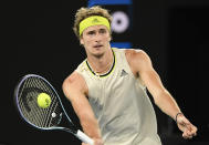 Germany's Alexander Zverev hits a forehand return to Serbia's Novak Djokovic during their quarterfinal match at the Australian Open tennis championship in Melbourne, Australia, Tuesday, Feb. 16, 2021.(AP Photo/Andy Brownbill)