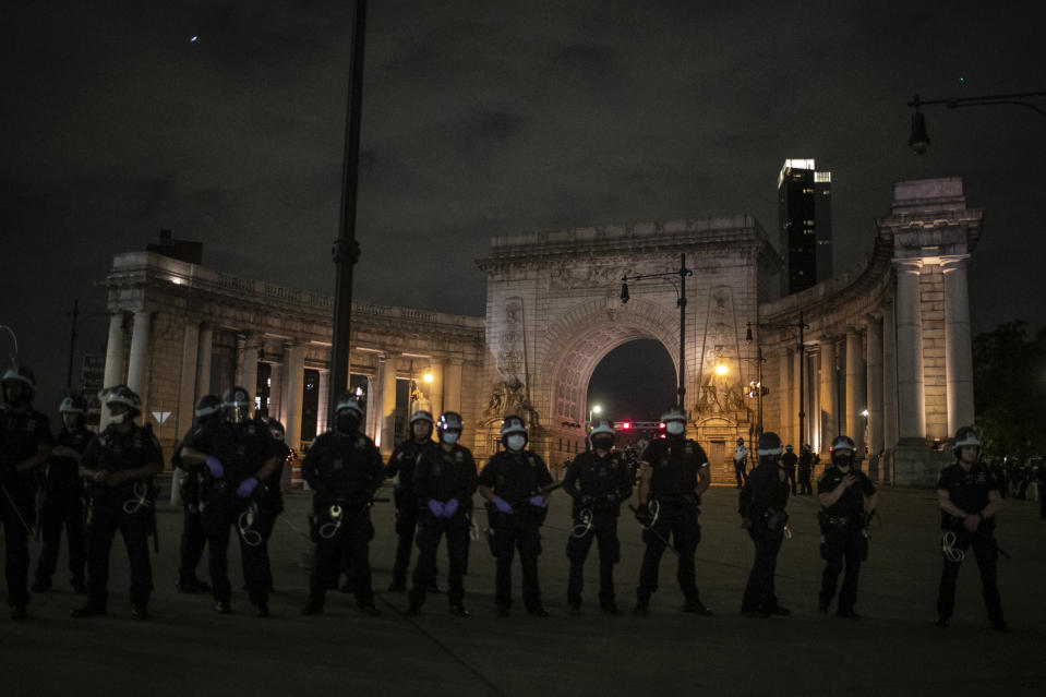 Police guard the entrance to the Manhattan Bridge that heads towards Brooklyn as protesters try to cross over during a solidarity rally calling for justice over the death of George Floyd Tuesday, June 2, 2020, in New York. Floyd died after being restrained by Minneapolis police officers on May 25. (AP Photo/Wong Maye-E)