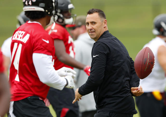"FILE - In this Tuesday, June 12, 2018, file photo, Atlanta Falcons offensive coordinator Steve Sarkisian does a behind-the-back pass to a player during an NFL minicamp football practice in Flowery Branch, Ga. Former USC head football coach Steve Sarkisian has lost a $30 million lawsuit that claimed he was improperly fired by the school instead of being allowed to seek treatment for alcoholism. In a statement Monday, July 9, 2018, Sarkisian said he was ""disappointed in the decision, but we will respect it and move on."" (AP Photo/John Bazemore, File)"