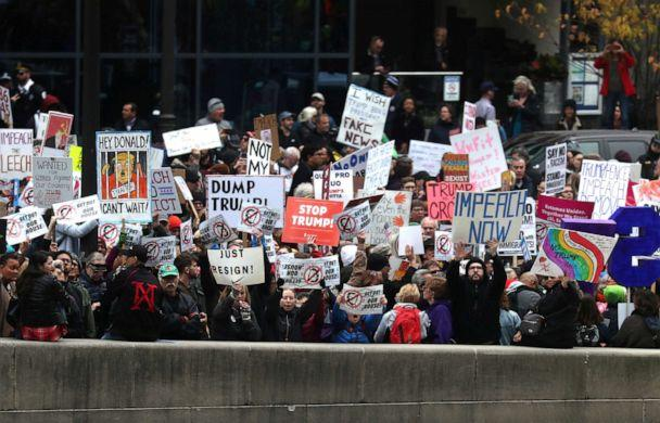 PHOTO: Demonstrators stage a protest across the river from Trump International Hotel and Tower while President Donald Trump visits in Chicago, Oct. 28, 2019. (Leah Millis/Reuters)
