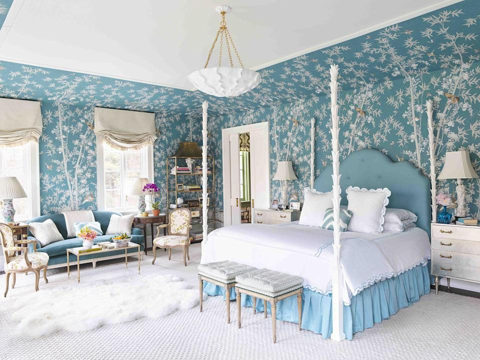 """<p>Color is always the topic of discussion in the <a href=""""https://www.veranda.com/decorating-ideas/a27105023/meg-braff-long-island-home/"""" rel=""""nofollow noopener"""" target=""""_blank"""" data-ylk=""""slk:master bedroom"""" class=""""link rapid-noclick-resp"""">master bedroom</a> of designer <a href=""""http://www.megbraffdesigns.com/"""" rel=""""nofollow noopener"""" target=""""_blank"""" data-ylk=""""slk:Meg Braff's"""" class=""""link rapid-noclick-resp"""">Meg Braff's </a>Long Island home. A peacock wallcovering by <a href=""""https://fave.co/2y1ZhHa"""" rel=""""nofollow noopener"""" target=""""_blank"""" data-ylk=""""slk:Schumacher"""" class=""""link rapid-noclick-resp"""">Schumacher</a> canopies the Serge Roche-inspired bed, set with bedding by <a href=""""https://fave.co/2L358UI"""" rel=""""nofollow noopener"""" target=""""_blank"""" data-ylk=""""slk:Satori Fine Linens"""" class=""""link rapid-noclick-resp"""">Satori Fine Linens</a>. The Roman shade fabric is by <a href=""""https://fave.co/2f4jkMV"""" rel=""""nofollow noopener"""" target=""""_blank"""" data-ylk=""""slk:Holland & Sherry"""" class=""""link rapid-noclick-resp"""">Holland & Sherry</a>, and the pendant lighting is <a href=""""https://fave.co/2IISIPU"""" rel=""""nofollow noopener"""" target=""""_blank"""" data-ylk=""""slk:Aerin"""" class=""""link rapid-noclick-resp"""">Aerin</a> for <a href=""""https://fave.co/2PvDwGp"""" rel=""""nofollow noopener"""" target=""""_blank"""" data-ylk=""""slk:Visual Comfort & Co."""" class=""""link rapid-noclick-resp"""">Visual Comfort & Co.</a></p>"""