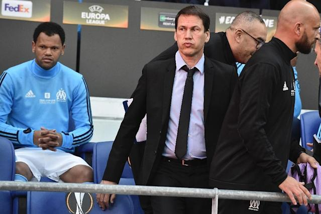 Marseille coach Rudi Garcia will have to motivate his team after the crushing disappointment of their Europa League final defeat (AFP Photo/Jeff PACHOUD )