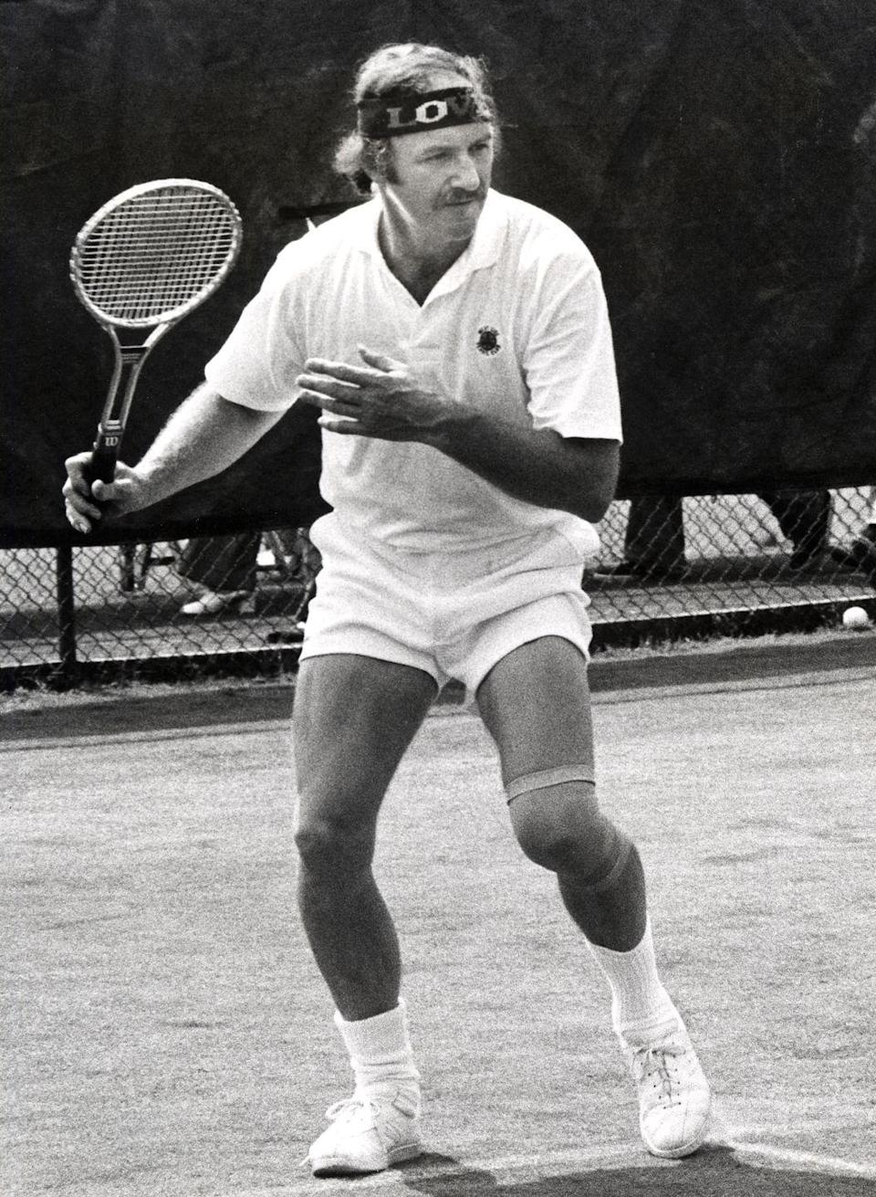 <p><em>Bonnie and Clyde</em> star Gene Hackman stands at the ready during a tennis match in 1973.</p>
