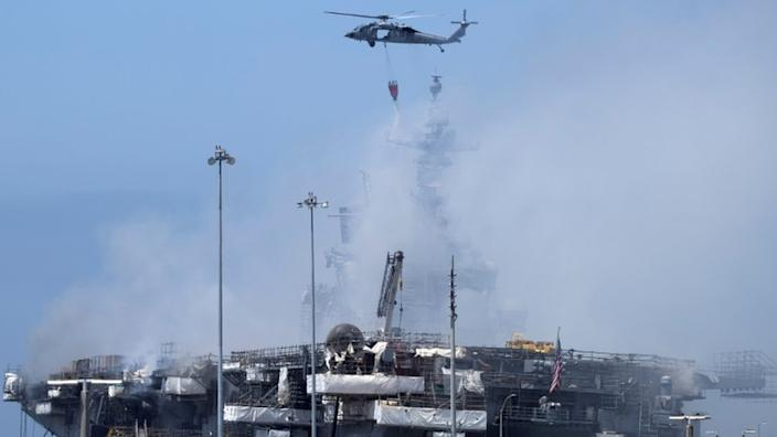 A US Navy helicopter continues fighting a fire on the amphibious assault ship USS Bonhomme Richard at Naval Base San Diego, in San Diego, California, U.S. July 13, 2020