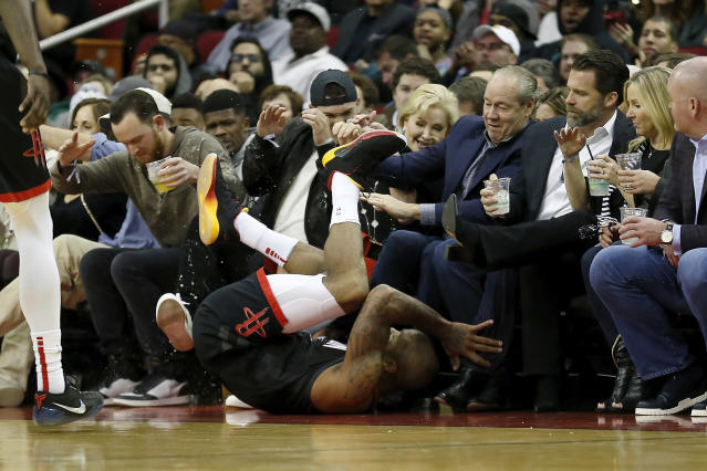P.J. Tucker dove into Alex Bregman at the Rockets game. (Getty Images)