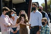 Canadian Prime Minister and Liberal Party leader Justin Trudeau (R) arrives with his family to cast his vote in the 2021 Canadian election in Montreal, Quebec on September 20, 2021 (AFP/Andrej Ivanov)