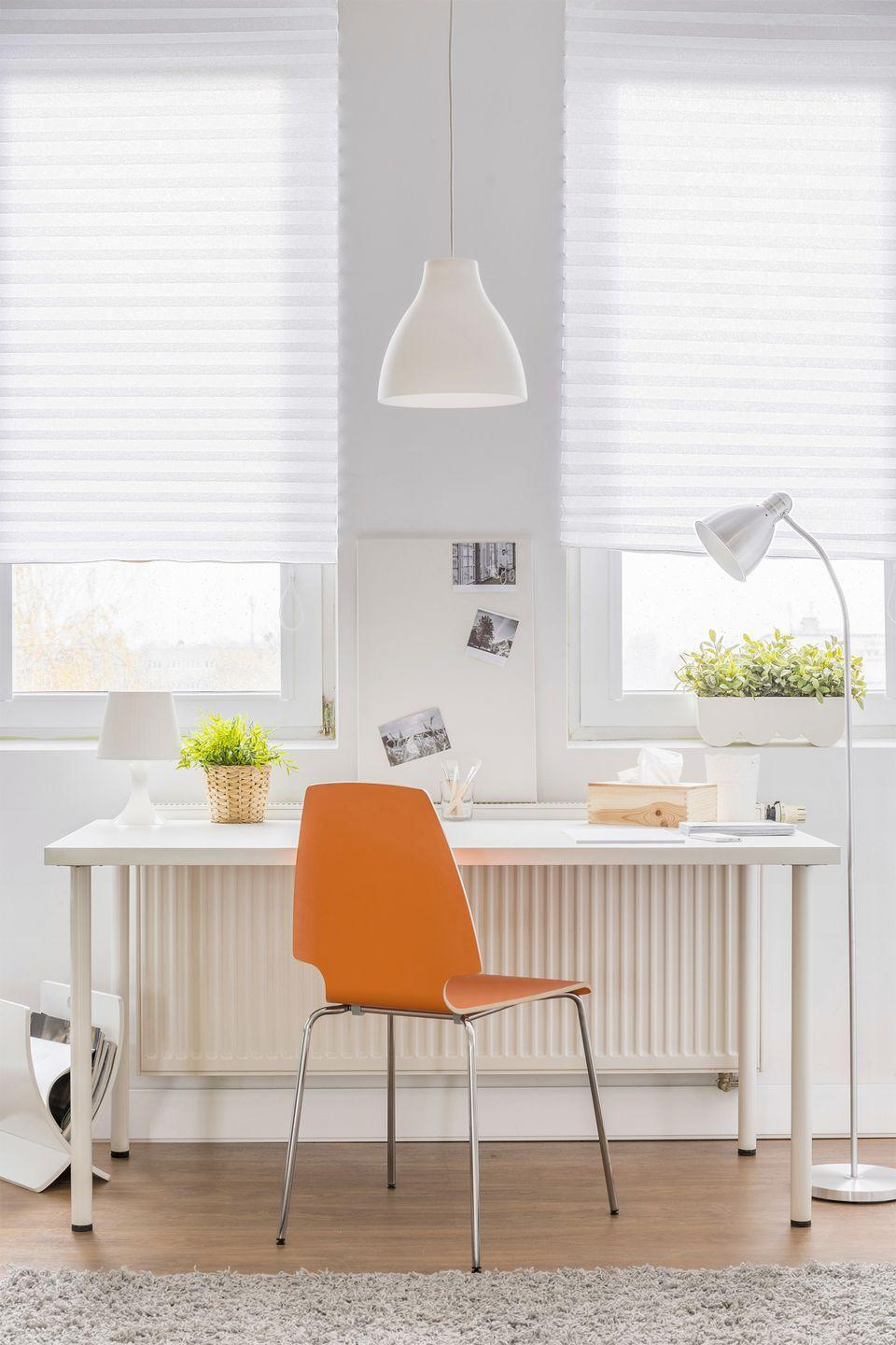 <p>Give your home office some Scandinavian-inspired flair by keeping your space light, airy, and minimalistic. Adding one colored piece — a bright orange desk chair, for example — makes a statement. </p>