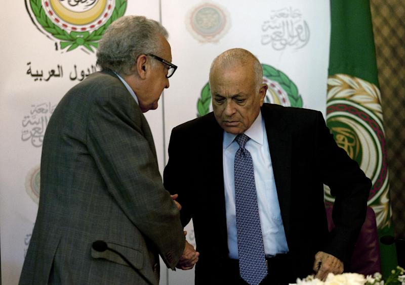 U.N.-Arab League envoy to Syria Lakhdar Brahimi, left, shakes hands with Arab League Secretary-General Nabil Elaraby following a joint press conference at the Arab League headquarters in Cairo, Egypt, Sunday, Dec. 30, 2012. The international envoy to Syria warned Sunday that as many as 100,000 could die in the next year if a solution is not reached quickly to end the country's civil war. (AP Photo/Nasser Nasser)