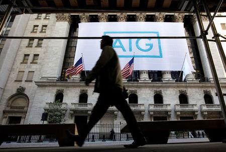 FILE PHOTO: A banner for American International Group Inc (AIG) hangs on the facade of the New York Stock Exchange, in New York, U.S., on October 16, 2012. REUTERS/Brendan McDermid/File Photo